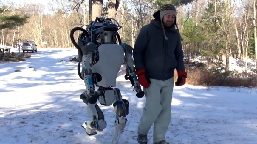 Boston Dynamics Atlas walking with a man